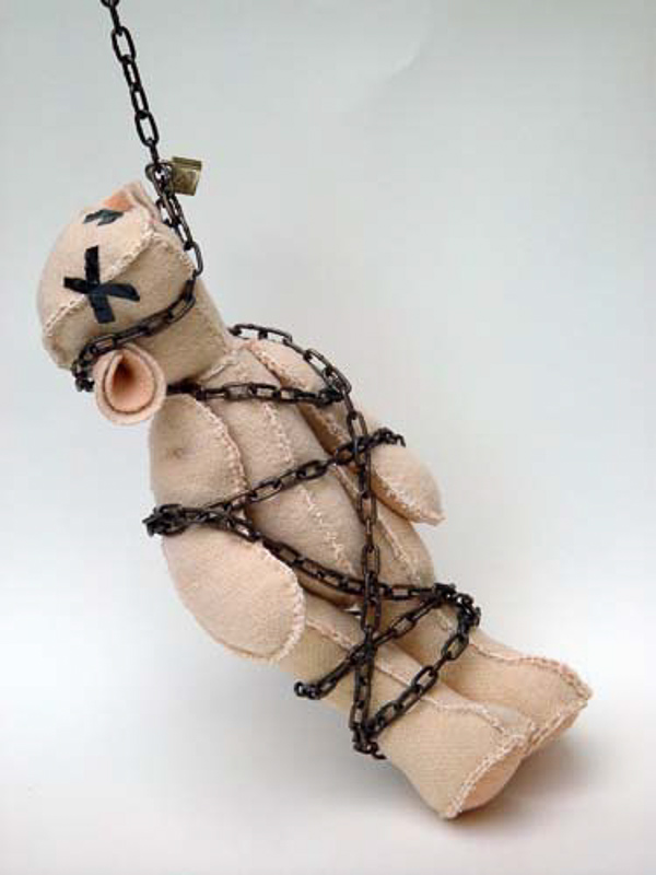 Geboeid (chained), teddy bear, blanket statue, 2008, 50x15x15 cm.